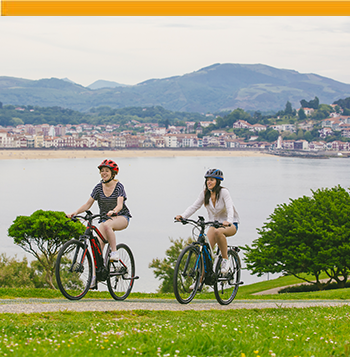 Two girls biking in the Basque Country