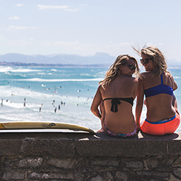 Surfer girls from the back