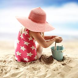 Little girl having fun on the sand