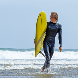 Surfer with a yellow board in the Basque Country
