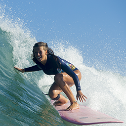 Surfer girl having fun