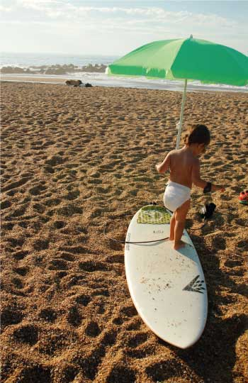 Kid playing with a surfboard