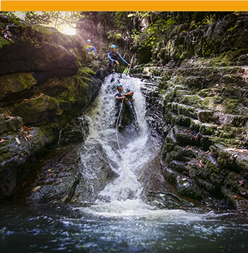 Man doing canyoning in the Basque Country