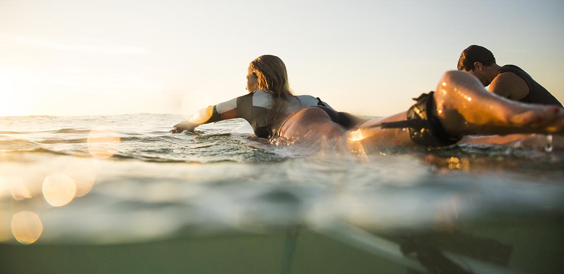 Girl surfing in Biarritz Pays Basque