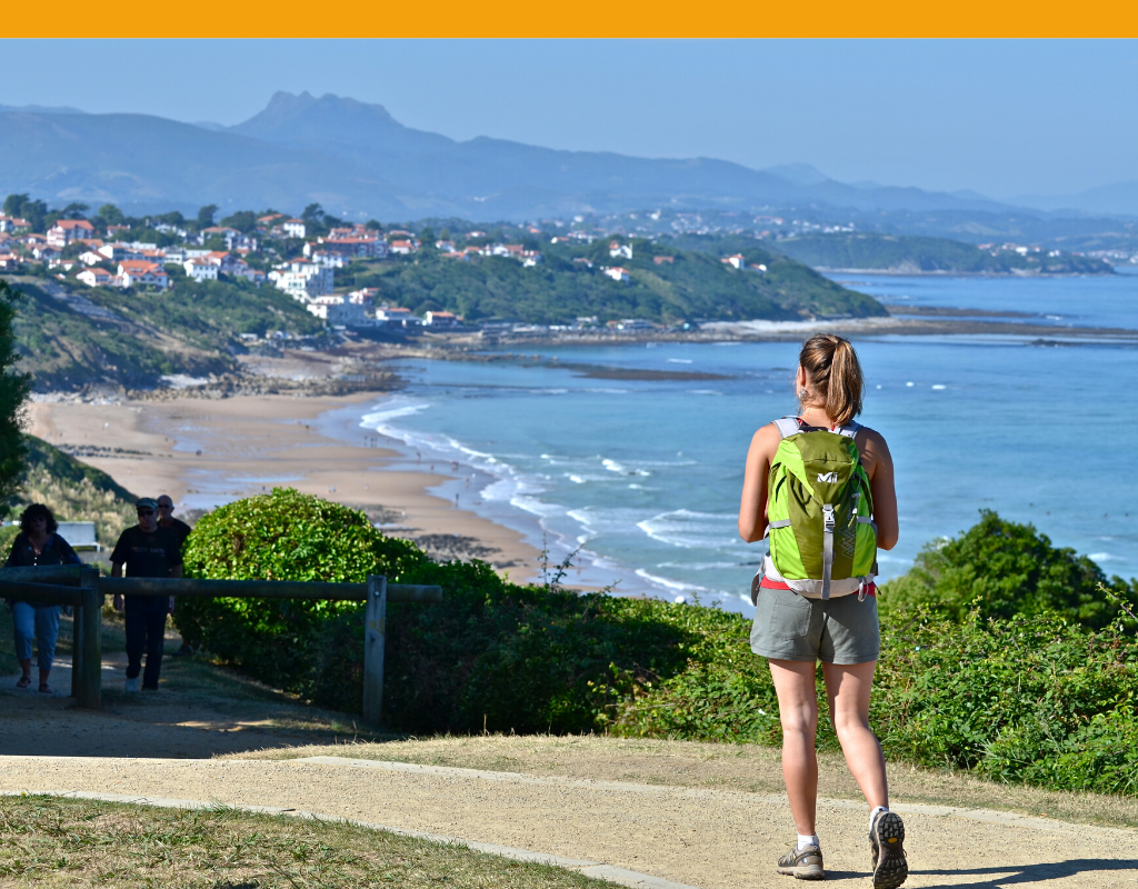 Girl walking on the coastal path in the Basque country